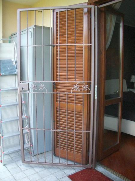 Inferriata porta con serratura2 carpenteria setten - Inferriata porta ...